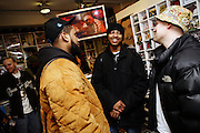 Cataclysm, 27, (left) and Iron Braydz, 26, (centre) are chatting with other artists in a Hip Hop music store in central London on Wednesday, Feb. 7, 2007.  Islamic Hip Hop artists like the duo 'Blind Alphabetz', from London, feel more than ever the need to say what they think aloud. In the music industry the backlash of a disputable Western foreign policy towards Islamic countries and its people is strong. The number of artists in the European Union and the US taking this into consideration and addressing the current social and political problems within their lyrics is growing rapidly and fostering awareness for Muslim and others alike.