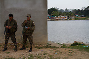 Guatemalan soldiers stand next to San Pedro river located in El Petén, north of Guatemala. This is a crucial point for central american migrants to enter into the south of Mexico. (Photo: Prometeo Lucero)