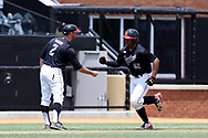 WINSTON-SALEM, NC - JUNE 04: Maryland's Marty Costes (42) celebrates his home run with Rob Vaughn (2) as he rounds third base. The West Virginia University Mountaineers played the University of Maryland Terrapins on June 4, 2017, at David F. Couch Ballpark in Winston-Salem, NC in NCAA Division I College Baseball Tournament Winston-Salem Regional Game 5. West Virginia won the game 8-5.