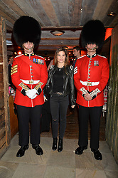Guardsmen and CARLY COLE wife of footballer Joe Cole at Skiing With Heroes Junior Committee Awareness Party held at Bodo's Schloss, 2A Kensington High Street, London on 6th November 2014.