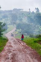 Women walking in the rain, Kabarole District, Uganda.