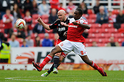 Bristol City Defender James O'Connor (ENG) passes as he is challenged by Swindon Forward Nile Ranger (ENG) during the first half of the match - Photo mandatory by-line: Rogan Thomson/JMP - Tel: 07966 386802 - 21/09/2013 - SPORT - FOOTBALL - County Ground, Swindon - Swindon Town v Bristol City - Sky Bet League 1.