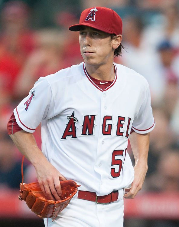 The Angels' Tim Lincecum walks to the dugout while pitching against the Boston Red Sox at Angel Stadium on Friday.<br /> <br /> ///ADDITIONAL INFO:   <br /> <br /> angels.0730.kjs  ---  Photo by KEVIN SULLIVAN / Orange County Register  -- 7/29/16<br /> <br /> The Los Angeles Angels take on the Boston Red Sox at Angel Stadium.