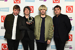 The Charlatans with the award for Classic Album at the Q Awards, at the Roundhouse in Camden, London. Picture date: Tuesday November 2, 2016. Photo credit should read: Matt Crossick/ EMPICS Entertainment.