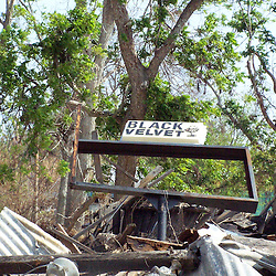 A sign is all that remains in the rubble of what was once the Black Velvet bar following the aftermath of Hurricane Katrina that flooded the small city of Buras, Louisiana in Plaquemines Parish on August 29, 2005. ..(Mandatory Credit: Photo by Derick E. Hingle)