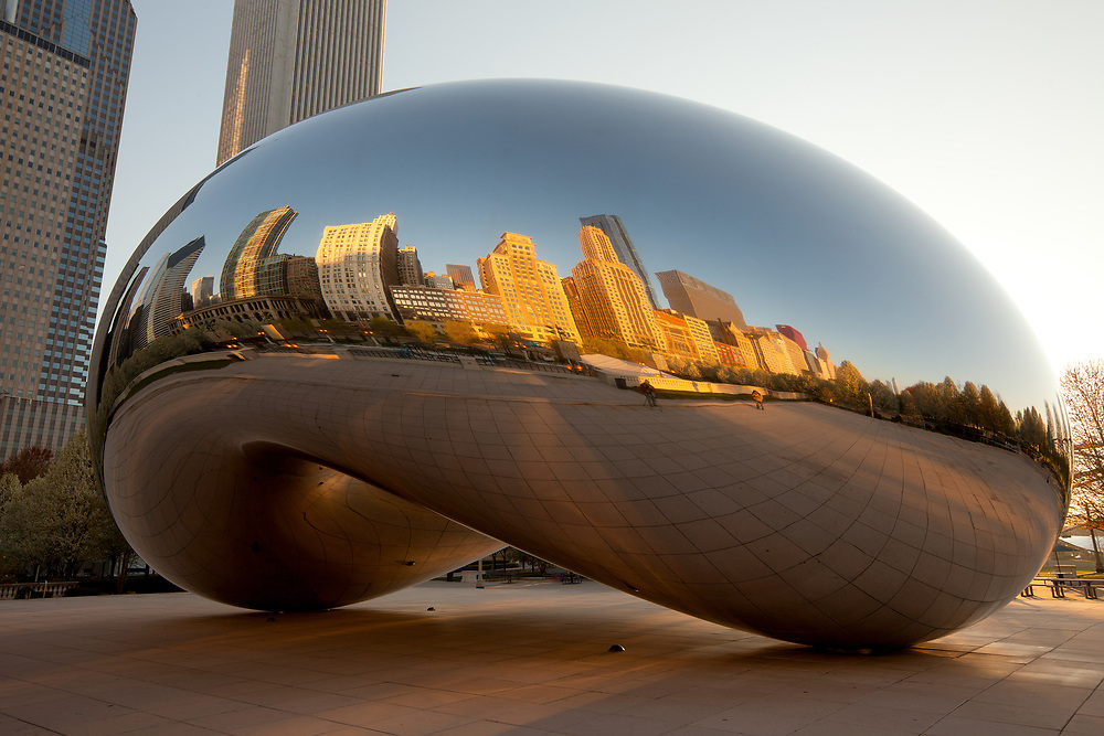 Chicago, Illinois, United States - Millennium Park and city skyline reflected on Cloud Gate, the famous sculpture created by artist Anish Kapoor.
