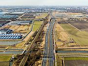 Nederland, Zuid-Holland, Zoetermeer, 20-02-2012; autosnelweg A12 gezien naar stadshart Zoetermeer, Den Haag aan de horizon.Motorway A12 seen in direction the Hague (skyline). .copyright foto/photo Siebe Swart