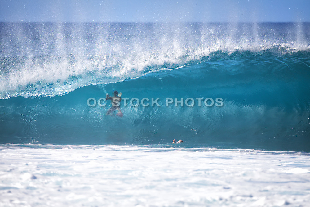Swimmers and Wave Photographer in the Ocean