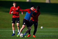 CARDIFF, WALES - Sunday, November 18, 2018: Wales' Ben Woodburn (L) and Kieron Freeman during a training session at the Vale Resort ahead of the International Friendly match between Albania and Wales. (Pic by David Rawcliffe/Propaganda)