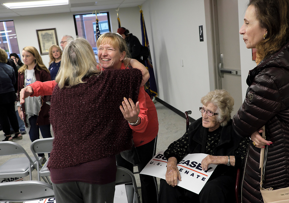 A supporter hugs Susan Wild, Democratic candidate for Pennsylvania's new 7th Congressional District, speaks to supporters during a rally featuring Senator Bob Casey on Nov. 4, 2018, at local IBEW in Allentown, Pennsylvania.