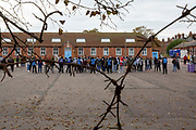 Refugees inside the barracks came out into the yard to enjoy the locals 'Welcome To Folkestone' event from local residents and community groups including Kent Refugee Action Network and Samphire came together outside Napier Barracks to show the people staying there that they are welcome to the town on the 17th of October 2020 in Folkestone, United Kingdom. In September 2020 Napier Barracks a former military camp was transformed into an assessment and dispersal facility for 400 asylum seekers by the Home Office. (photo by Andrew Aitchison)