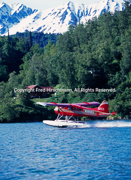 Rust's Flying Service de Havilland Beaver taking off from Big River Lakes with Redoubt Bay Lodge beyond, Alaska.