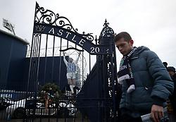 A West Bromwich Albion fan walks through the Jeff Astle gates before the Premier League match at The Hawthorns, West Bromwich.