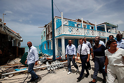 France's President Emmanuel Macron walks with residents during his visit in the French Caribbean islands of St. Martin , Tuesday, Sept. 12, 2017. Macron is in the French-Dutch island of St. Martin, where 10 people were killed on the French side and four on the Dutch. Photo by Christophe Ena/Pool/ABACAPRESS.COM