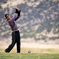 041813       Brian Leddy<br /> Kirtland Central Bronco Jared Noble tees off during Thursday's Grants Invitational Golf Tournament at Coyote del Malpais golf course.