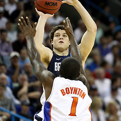 Mar 24, 2011; New Orleans, LA; Brigham Young Cougars guard Jimmer Fredette (32) Florida Gators guard Kenny Boynton (1) during the first half of the semifinals of the southeast regional of the 2011 NCAA men's basketball tournament at New Orleans Arena.  Mandatory Credit: Derick E. Hingle