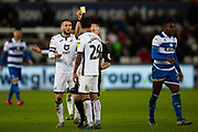Swansea City defender Kyle Naughton (26) is booked during the EFL Sky Bet Championship match between Swansea City and Queens Park Rangers at the Liberty Stadium, Swansea, Wales on 11 February 2020.