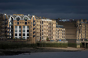 Sunlight illuminates windows and balconies of riverside residential apartment properties at the former docks warehouses at New Crane Wharf in Wapping, on 17th January 2020, in London, England.