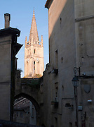 Narrow streets and the church steeple in the historic town of Saint Emilion, France