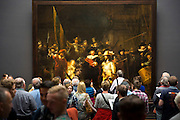 Visitors view famous 17th Century painting by Rembrandt 'The Night Watch' at Rijksmuseum in Amsterdam, Holland
