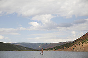 SHOT 6/8/16 8:48:42 AM - Flaming Gorge Reservoir straddles the Utah-Wyoming border and was completed in 1964. The reservoir is mainly in southwest Wyoming and partially in northeastern Utah. The northern tip of the reservoir is 10 miles southeast of Green River, Wyoming, 14 miles southwest of Rock Springs, Wyoming, and 43 miles north of Vernal, Utah. Visitors enjoy world class fishing, hiking, boating, windsurfing, camping, backpacking, cross-country skiing, and snowmobiling within Flaming Gorge National Recreation Area, which is operated by Ashley National Forest. (Photo by Marc Piscotty / © 2016)