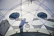 Julie Markus, graduate student at Ohio State University, sets up the large tent at the field camp at Columbia Glacier, near Valdez, Alaska.