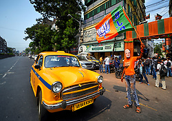 May 23, 2019 - Kolkata, WEST BENGAL, India - A supporter of Bharatiya Janata Party (BJP) seen wearing a Mask of Narendra Modi while weaving BJP Flags in front of the Party Head quarter in Kolkata after making massive Win in West Bengal & India election. (Credit Image: © Avishek Das/SOPA Images via ZUMA Wire)