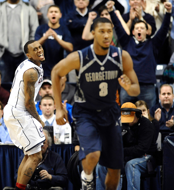 Connecticut's Ryan Boatright, left, reacts during the first overtime of an NCAA college basketball gameagainst Georgetown in Storrs, Conn., Wednesday, Feb. 27, 2013. Georgetown won 79-78. (AP Photo/Jessica Hill)