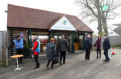 Racegoers arriving ahead of Injured Jockeys Fund Charity Raceday at Plumpton Racecourse.