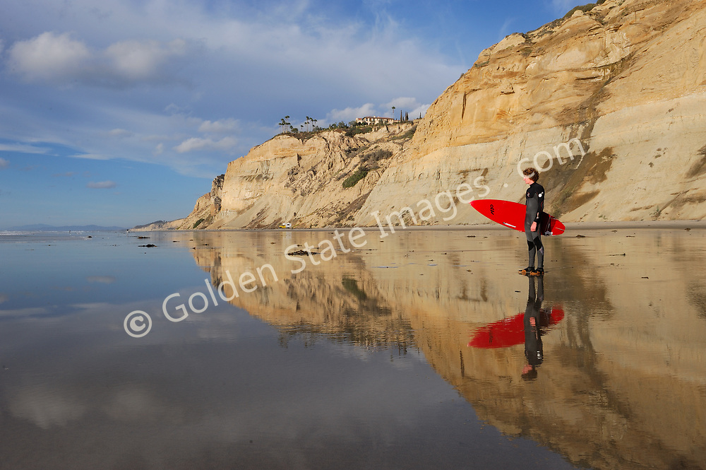 Surfers reflection on the tidal flats late afternoon light. (Not Model Released)
