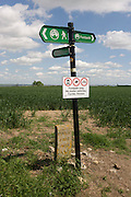 A remote signpost showing the Saxon Shore Way near Halstow on the Kent Thames estuary marshes, potentially threatened by the future London airport.