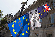 A day after British Prime Minister Boris Johnson successfully asked the Queen to suspend prorogue Parliament in order to manoeuvre his Brexit deal with the EU in Brussels, Remain banners and flags fly outside the Cabinet Office  in Whitehall, on 29th August 2019, in Westminster, London, England.