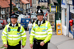 Policeman and Community Support Officer chat to an elderly couple; Scarborough; Yorkshire UK