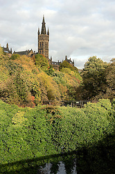 Looking to wards the university the leaves on the trees turn from green to  autumnal red and gold in Glasgow  October 2010 .Images © Paul David Drabble