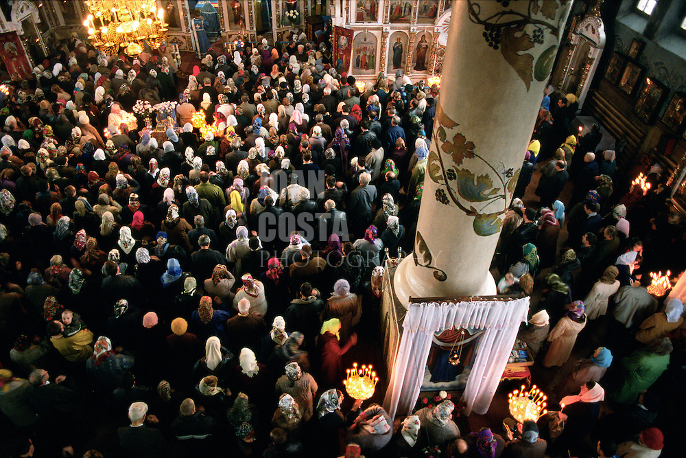 Ukraine. Smila. The faithful attending a mass at the Cathedral.<br /> <br /> © JOAN COSTA
