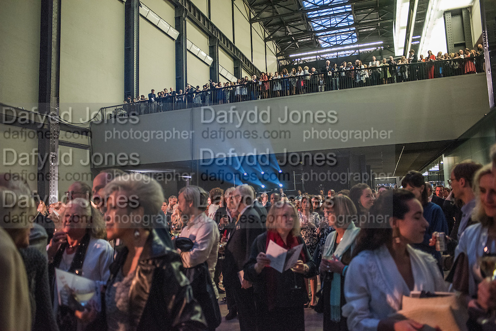 GALLERYGOERS LISTENING TO FRANCES MORRIS OPENING SPEECH, New Tate Modern opening party, Bankside. London. 16 June 2016