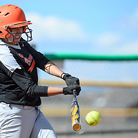 Gallup Bengal Ashley Yellowhorse (9) connects with the ball during the game against Farmington at Gallup High School Friday.