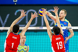 Tine Urnaut of Slovenia vs Simon Guerra Uteau of Chile and Matias Banda of Chile during volleyball match between Slovenia and Chile in Group A of FIVB Volleyball Challenger Cup Men, on July 3, 2019 in Arena Stozice, Ljubljana, Slovenia. Photo by Matic Klansek Velej / Sportida