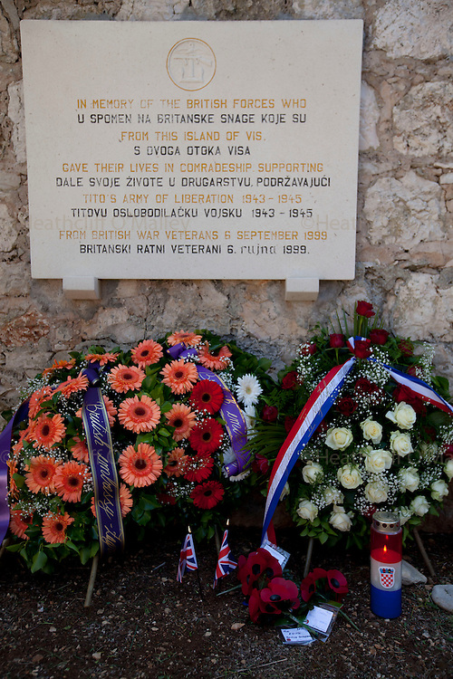 Mcc0031516 . Daily Telegraph..Wreaths laid at a memorial service on the island of Vis, Croatia .. A reunion of British WW2 Veterans, probably for the last time. They are some of the last survivors of an Allied combined garrison of Royal Navy, Royal Marine Commandos, Army and Royal Air Force personnel who took over the Island in 1943 and held it until the end of the War. From here they harried Axis Forces in what was Yugoslavia, providing supply drops to the Partisans and, at one point, refuge for Marshall Tito when he was nearly captured by German Forces ...18 May 2011 Vis, Croatia