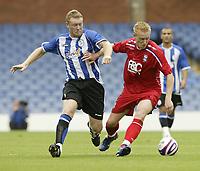 Photo: Aidan Ellis.<br /> Sheffield Wednesday v Birmingham City. Pre Season Friendly. 04/08/2007.<br /> Birmingham's Mikkael Forssell (R) holds off Wednesday's Steve Watson