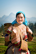 Vietnam, Bac Ha. Flower Hmong woman wearing a traditional dress.