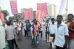 June 19, 2017 - Kolkata, West Bengal, India - All India Krishak Khet Majdoor Sangathan activists protested against police action over the protesting farmers at Mandsaur, Madhya Pradesh and burn the effigy of Prime Minister Narendra Modi. (Credit Image: © Saikat Paul/Pacific Press via ZUMA Wire)