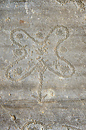 Petroglyph, rock carving, of the so called Camuni Rose, emblem of Lombardy,  named after and carved by the ancient Camunni people in the iron age between 1000-1600 BC. Rock no 24,  Foppi di Nadro, Riserva Naturale Incisioni Rupestri di Ceto, Cimbergo e Paspardo, Capo di Ponti, Valcamonica (Val Camonica), Lombardy plain, Italy .<br /> <br /> Visit our PREHISTORY PHOTO COLLECTIONS for more   photos  to download or buy as prints https://funkystock.photoshelter.com/gallery-collection/Prehistoric-Neolithic-Sites-Art-Artefacts-Pictures-Photos/C0000tfxw63zrUT4<br /> If you prefer to buy from our ALAMY PHOTO LIBRARY  Collection visit : https://www.alamy.com/portfolio/paul-williams-funkystock/valcamonica-rock-art.html
