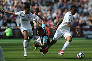 Manuel Lanzini of West Ham United (c) is fouled by Kyle Naughton of Swansea City (L). Premier league match, West Ham Utd v Swansea city at the London Stadium, Queen Elizabeth Olympic Park in London on Saturday 8th April 2017.<br /> pic by Steffan Bowen, Andrew Orchard sports photography.