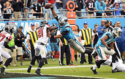 November 5, 2017 - Charlotte, NC, USA - Carolina Panthers quarterback Cam Newton (1) dives over the goal line past Atlanta Falcons cornerback Desmond Trufant (21) for a touchdown in the first half on Sunday, Nov. 5, 2017 at Bank of America Stadium in Charlotte, N.C. (Credit Image: © David T. Foster Iii/TNS via ZUMA Wire)