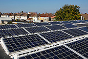 The 25kWsolar PV array on the roof of Knowle West Media Centre. Supported by Bristol Energy, a community-owned energy cooperative, growing Greater Bristol's local green energy supply and making the benefits available to all. Bristol, UK.