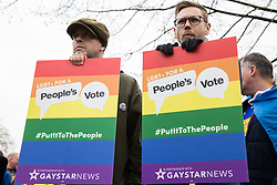 London, UK. 23rd March, 2019. Members of the LGBT+ community prepare to take part in a People's Vote march through central London before attending a rally in Parliament Square addressed by politicians and entertainers.