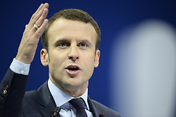 """Former French Economy Minister, founder and president of the political movement """"En Marche !"""" and candidate for next year's presidential election Emmanuel Macron gestures during the campaign rally at porte de Versailles in Paris, France, on December 10, 2016. Photo by Eliot Blondet/ABACAPRESS.COM"""