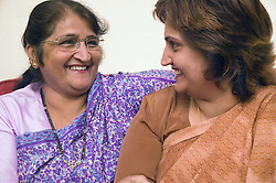 Mother and daughter together at home,