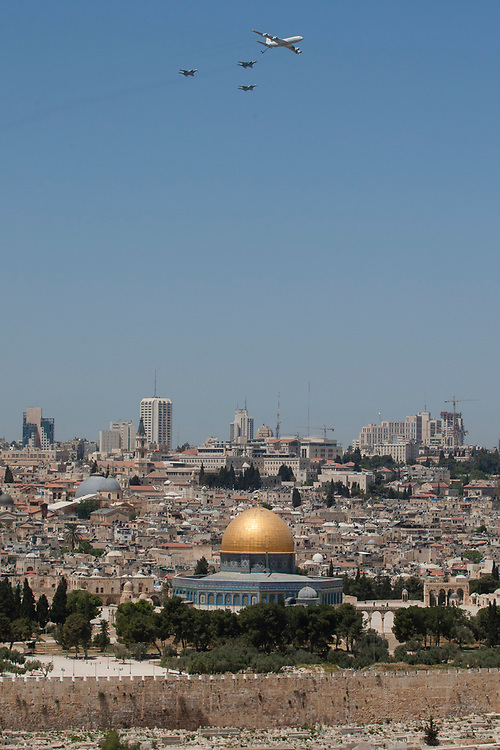 A KC-135 Stratotanker Boeing 707 plane and three Israeli Air Force F-15 fighter jets fly in formation over the golden Dome of the Rock Islamic shrine in Jerusalem's Old City, during Israel's 64th Independence Day anniversary celebrations, on April 26, 2012.